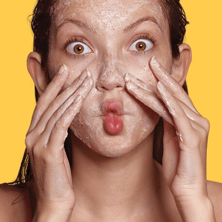 yellow background model scrubbing face